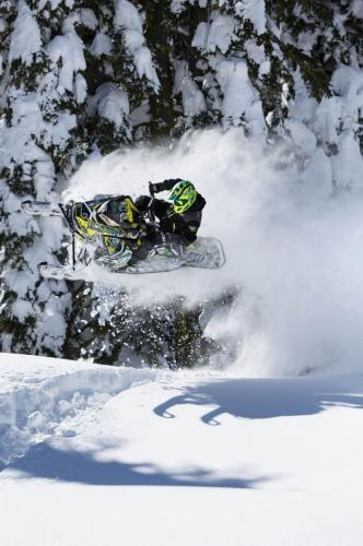 Duncan Lee jumping on snowmobile